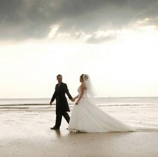 Claire Tregaskis Photography, bride and groom, coast, walking